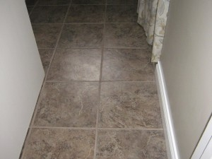 New tile floor, included new sub-floor, and baseboard. Bathroom was also painted.
